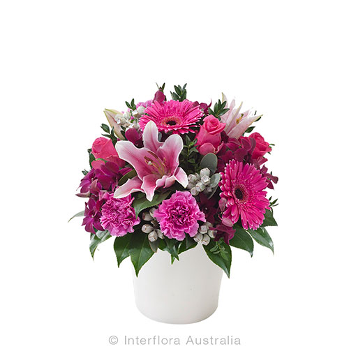 Beautiful floral arrangement of pink flowers in a round pot