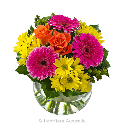 Beautifuly coloured flower arrangement in round vase