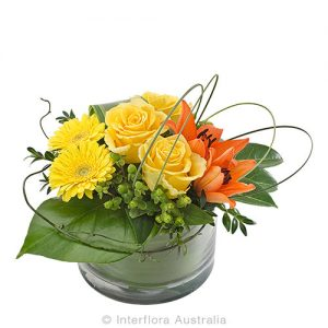 Colourful floral arrangement in a round glass vase