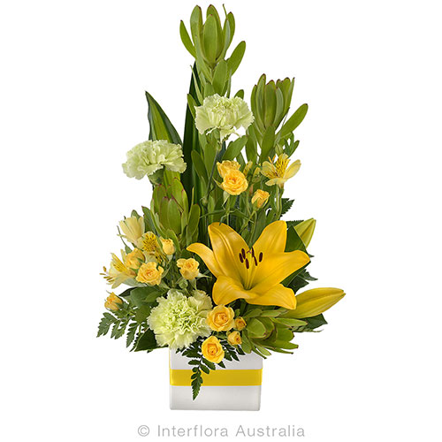 Fresh flower arrangement in a mini box
