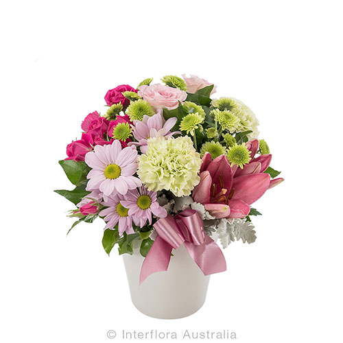 Pastel floral arrangement in a round ceramic pot