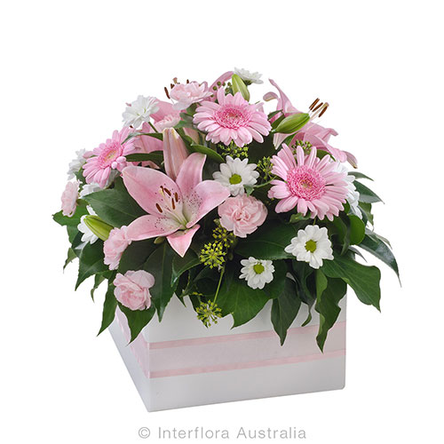 Thoughts of you with gentle pink flowers in a box