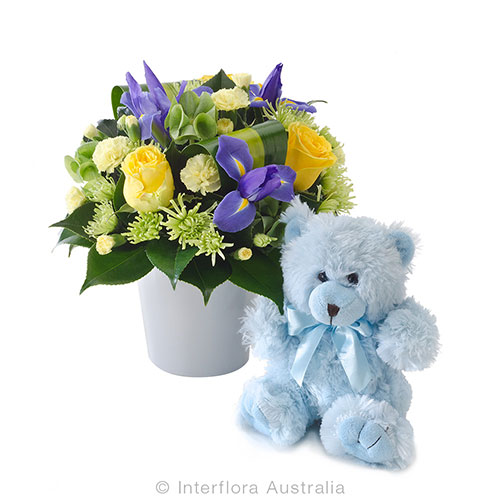 Bright mix arrangement of flowers with teddy