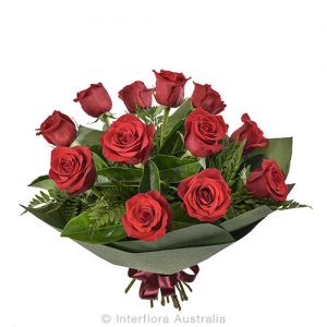 12 roses in a beautiful round bouquet