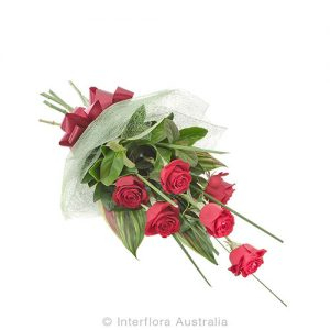 6 red roses arranged in a bouquet