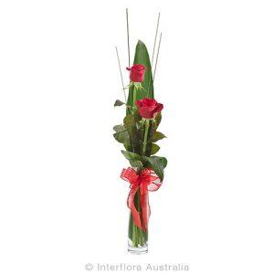 2 roses in an elegant flute vase