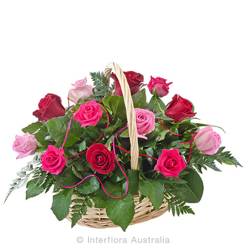 12 mixed roses in a lovely basket