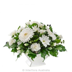 Simplicity in white. A white flower arrangement in a basket