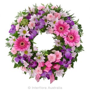A heartfelt sympathy wreath in pinks