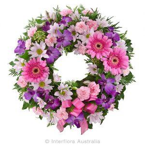 A heartfelt sympathy wreath in pinks